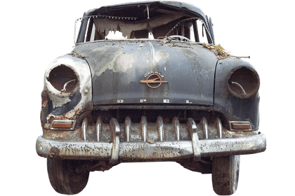 Old wrecked car facing the camera